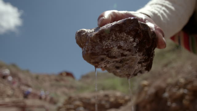 cu a stone is lifted up out of water - mineral stock videos & royalty-free footage