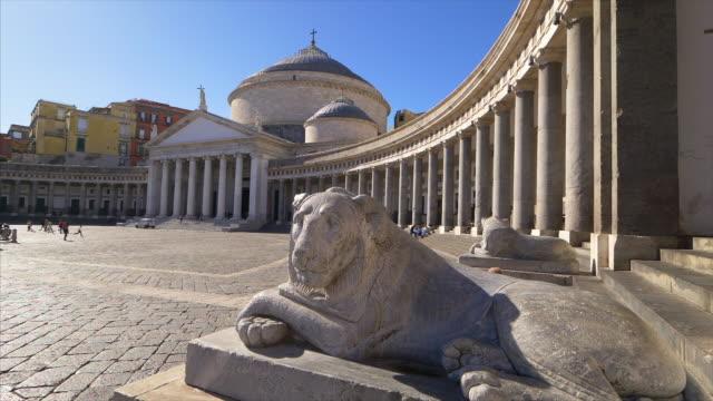stone lion statue in front of piazza del plebiscito in naples, italy, slow motion - プレビシート広場点の映像素材/bロール