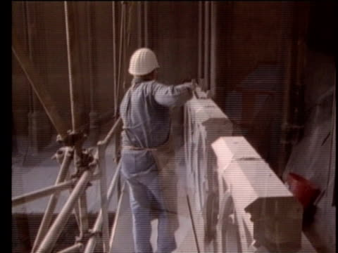 1990 montage stone masons working on portions of cologne cathedral, cologne, germany, audio - baugerüst stock-videos und b-roll-filmmaterial