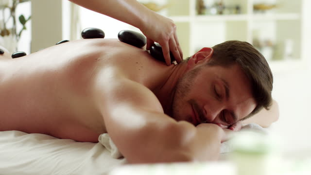 stone massage - spa treatment stock videos & royalty-free footage