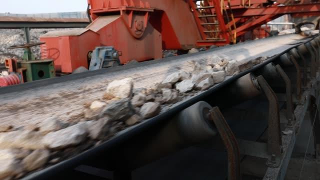 stone material on a factory conveyor belt - conveyor belt stock videos & royalty-free footage
