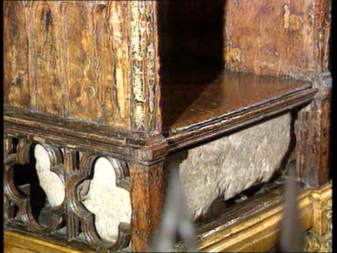 stone of destiny to rest in edinburgh castle; itn lib england: london: westminster abbey: int cms stone of destiny stored under throne in pull out - edinburgh castle stock videos & royalty-free footage