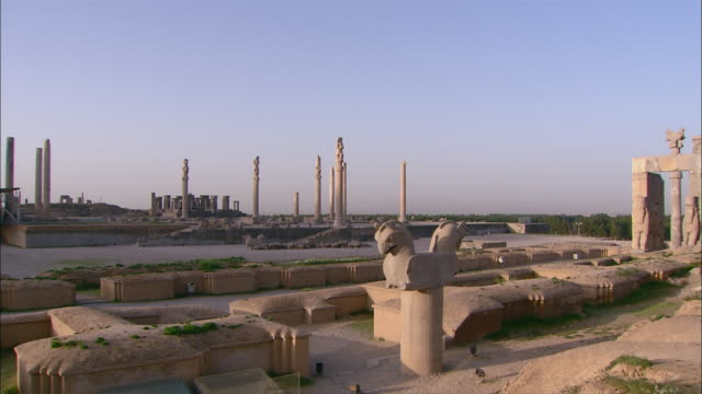stone pillars and other artifacts comprise the ancient city of persepolis. - persepoli video stock e b–roll