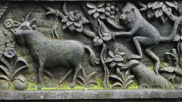 ms stone relief in pura dalem agung temple in monkey forest / ubud, bali, indonesia - ubud district stock videos & royalty-free footage