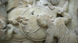 Stone relief representation of greek goddess Athena in the Gigantomachy battle