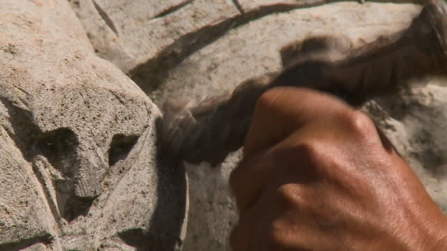 stone sculptor at work, cusco, peru - stone object stock videos & royalty-free footage