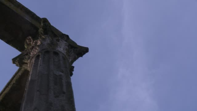 stone slabs span columns atop ancient roman ruins. - évora district stock videos & royalty-free footage