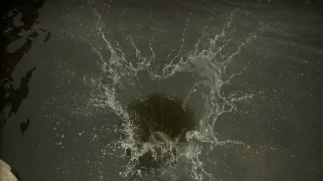 Stone splash in river