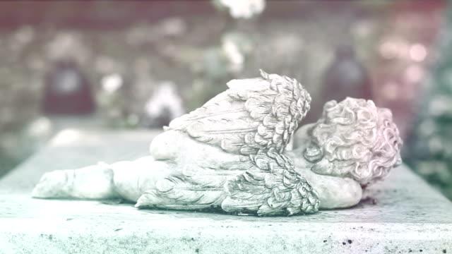 Stone statue of the sleeping cherub