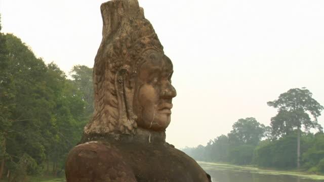 zi stone statues along entrance to angkor thom / angkor, cambodia - male likeness stock videos & royalty-free footage