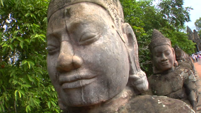 cu stone statues at bayon temple, angkor, cambodia - anthropomorph stock-videos und b-roll-filmmaterial