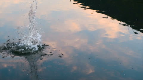 stone thrown into the water - stone material stock videos & royalty-free footage