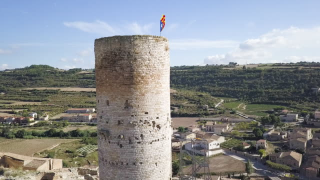 Stone tower in Catalonia, panning aerial