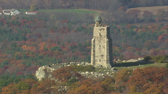 AERIAL Stone tower on top of Skytop cliff near Mohonk Mountain House / New Paltz, New York, United States
