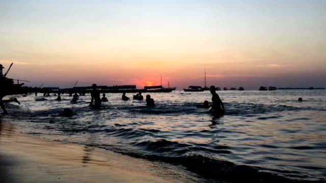 stone town beach activity during sunset - cultures stock videos & royalty-free footage