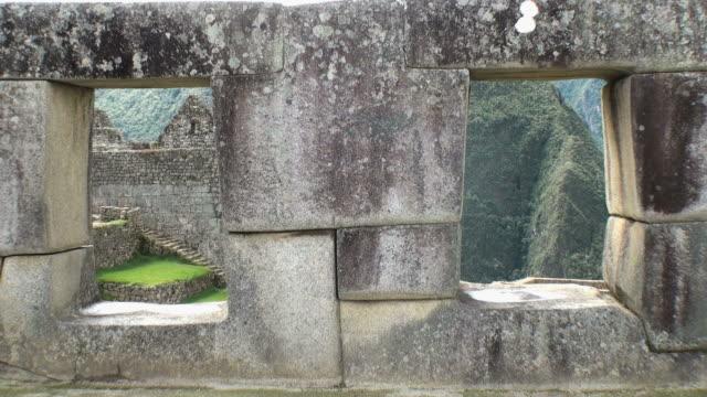 ws  stone wall at temple of three windows / machu picchu, peru  - machu picchu stock videos & royalty-free footage