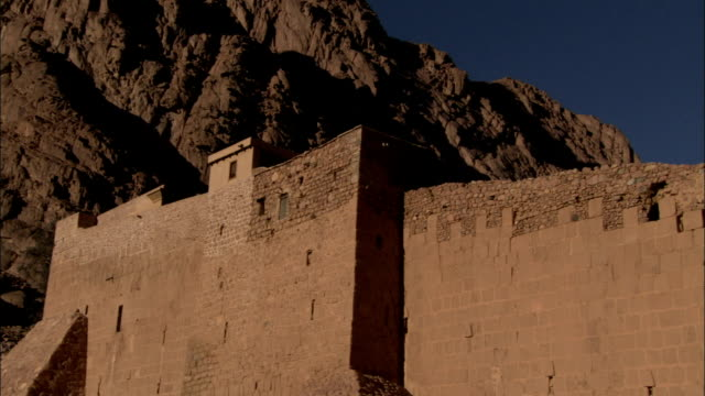 A stone wall hides Saint-Catherine's Monastery in Egypt. Available in HD.