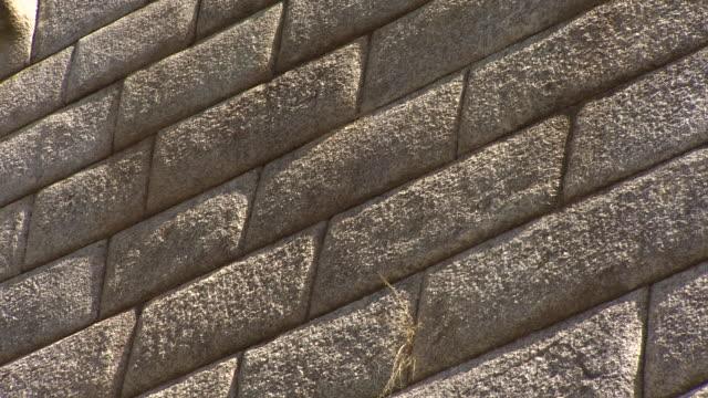 stone wall in machu picchu, peru - stone wall stock videos and b-roll footage