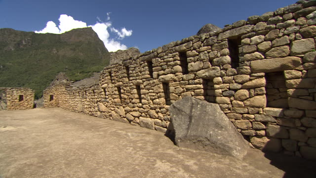 a stone wall surrounds a courtyard in machu picchu. - stone wall stock videos and b-roll footage