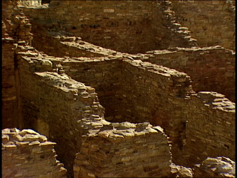 stone walls mark off rooms in the ruins of pueblo bonito in chaco canyon. - chaco canyon stock videos & royalty-free footage