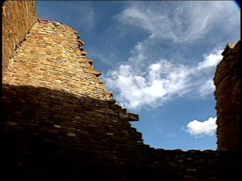 stone walls of the pueblo bonito ruins rise into the sky. - pueblo bonito stock videos & royalty-free footage