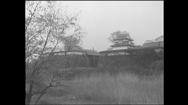 Stone walls surround the tower and gate at the Fukuoka Castle Ruins.
