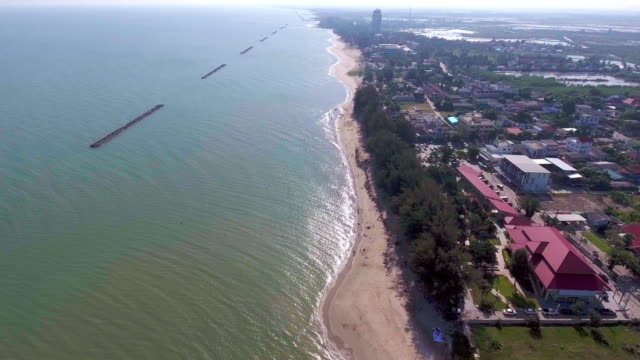 stone wave breaker on the beach, aerial video - fare la guardia video stock e b–roll
