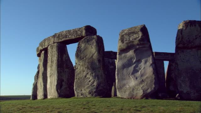 stonehenge rises above the salisbury plain. - obelisk stock videos & royalty-free footage