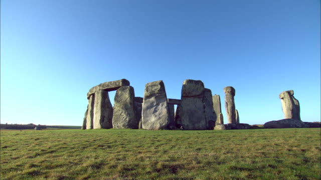 stonehenge stands on a hill on salisbury plain.. - obelisk stock videos & royalty-free footage