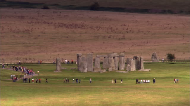 low aerial, stonehenge, wiltshire, england - stonehenge stock videos and b-roll footage
