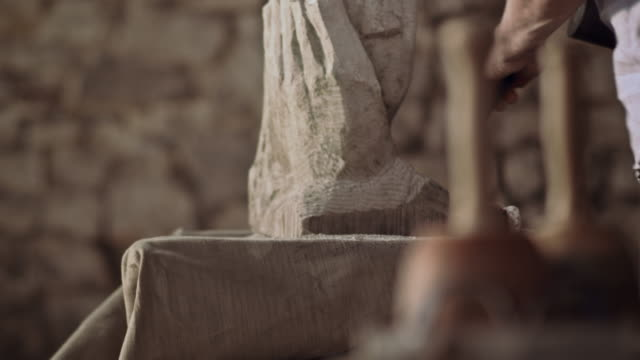 stonemason carving stone with chisel - carving craft product stock videos & royalty-free footage