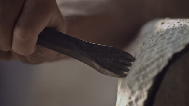 stonemason carving stone with hammer and chisel - stone object stock videos and b-roll footage