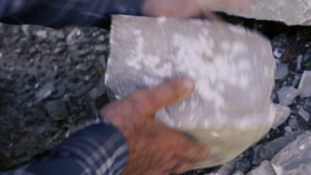 stonemason cutting a block of granite with sledgehammer. - granite rock stock videos & royalty-free footage