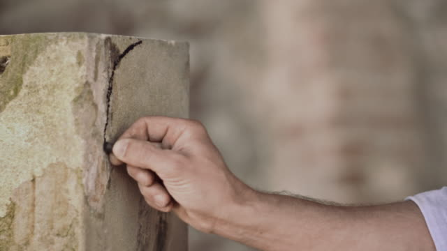 stonemason drawing on stone - stone material stock videos & royalty-free footage