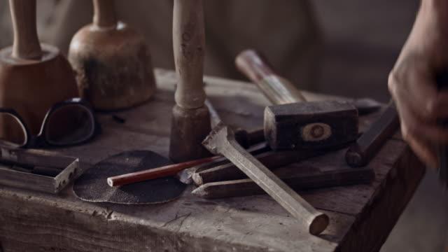 Stonemason grabs tool