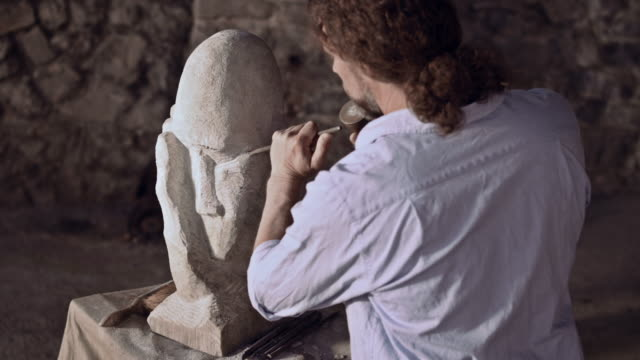 stonemason starts carving stone with hammer and chisel - stone material stock videos & royalty-free footage