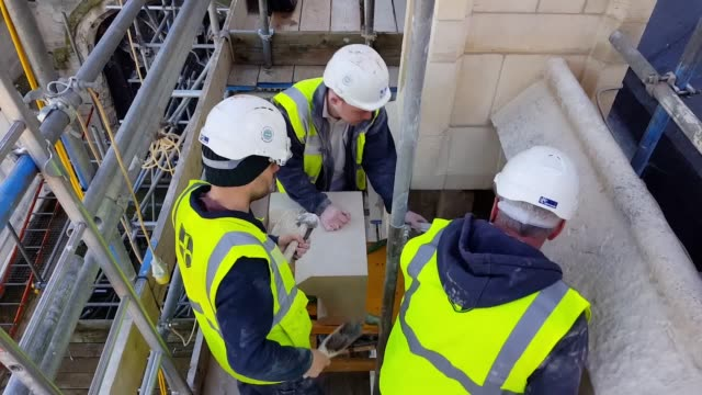 stonemasons at canterbury cathedral in kent prepare to install the first of eight new gargoyles, which are the first to be put on the building in... - canterbury cathedral stock videos & royalty-free footage