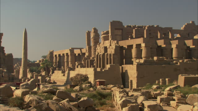 stones and rubble litter a road that leads to the ancient city of karnak, egypt. - temples of karnak stock videos & royalty-free footage