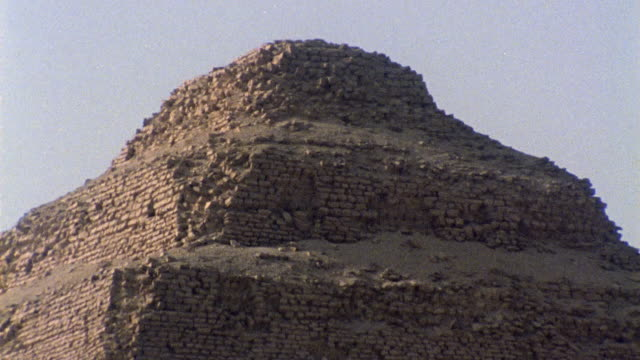 cu zo stones atop step pyramid of zoser / saqqara, egypt - saqqara stock videos and b-roll footage