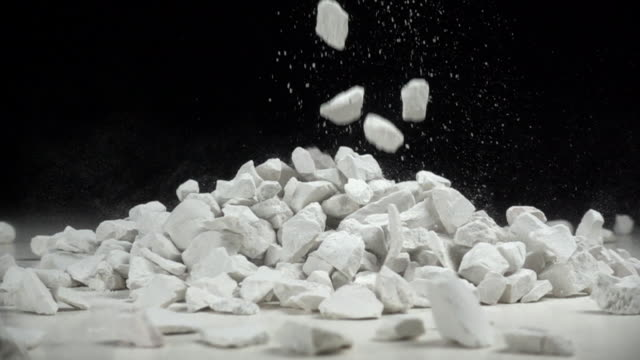 stones fall in slow motion - stone material stock videos & royalty-free footage