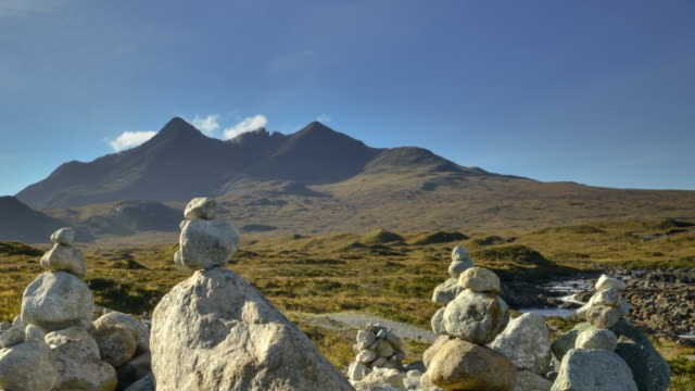 Stones from the river Sligachan are stacked by visitors to the Cuillins on the Isle Of Skye in the Scottish Highlands