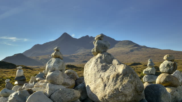 stones from the river sligachan are stacked by visitors to the cuillins on the isle of skye in the scottish highlands - hebrides stock videos & royalty-free footage