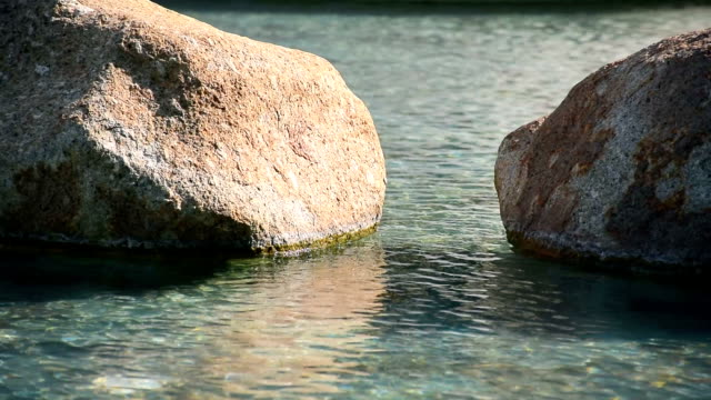 Stones in the shining water