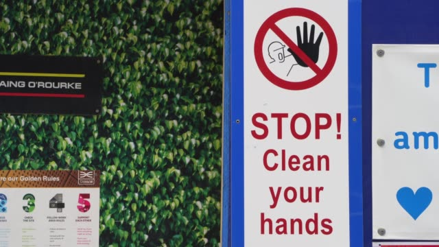 stop and clean your hands sign is in pace at a building site in the city of london on august 02 2020 in london england - central london stock videos & royalty-free footage