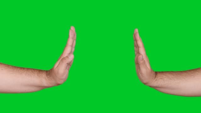vídeos de stock e filmes b-roll de 4k stop gesture on chroma key - articulação humana