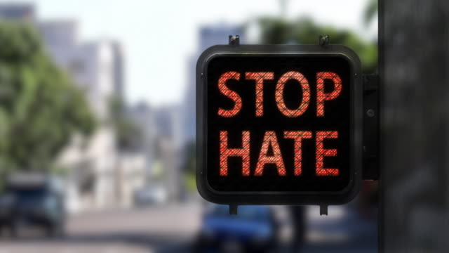 stop hate. have hope—medium shot of walk signal with hopeful social message - political rally stock videos & royalty-free footage
