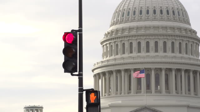 stop light and the us capital in washington d.c. - bureaucracy stock videos & royalty-free footage