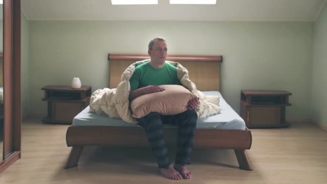 stop motion animation about men and pillow with blanket