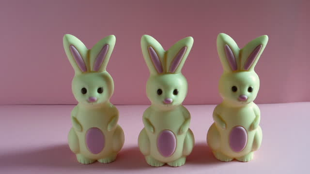 stop motion animation of easter bunnies walking past and stop to look at camera. - medium group of objects stock videos & royalty-free footage
