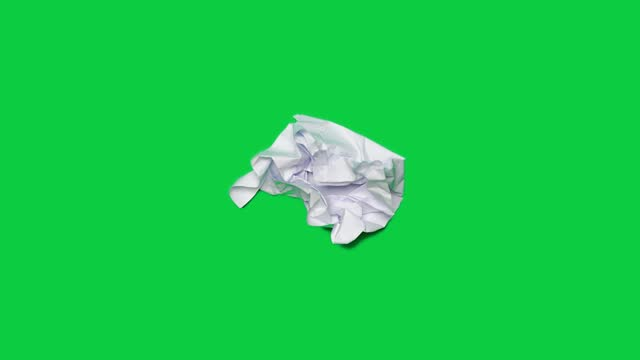 stop motion animation paper wrinkles making a paper ball. mint green background - paper stock videos & royalty-free footage
